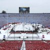 Photo - The hockey rink in Michigan Stadium is shown for the NHL Winter Classic outdoor hockey game between the Detroit Red Wings and Toronto Maple Leafs Tuesday, Dec. 31, 2013, in Ann Arbor, Mich. The game is scheduled for New Year's Day.  (AP Photo/Paul Sancya)