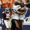 Oklahoma State\'s Jeremy Smith (31) and Josh Stewart (5) celebrate a touchdown run by Smith in the third quarter during the AdvoCare Texas Kickoff college football game between the Oklahoma State University Cowboys (OSU) and the Mississippi State University Bulldogs (MSU) at Reliant Stadium in Houston, Saturday, Aug. 31, 2013. OSU won, 21-3. Photo by Nate Billings, The Oklahoman