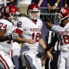 Oklahoma\'s Adam Shead (74), Landry Jones (12) and Jalen Saunders (18) celebrate Saunders\' touchdown reception against TCU in the first half of an NCAA college football game Saturday, Dec. 1, 2012, in Fort Worth, Texas. (AP Photo/Tony Gutierrez)