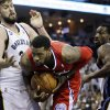 Photo -   Los Angeles Clippers' DeAndre Jordan, center, moves between Memphis Grizzlies' Marc Gasol, of Spain, left, and Tony Allen (9) during the first half of Game 2 in their first-round NBA basketball playoff series in Memphis, Tenn., Wednesday, May 2, 2012. (AP Photo/Danny Johnston)