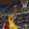 West Virginia\'s Gary Browne, right, scores ahead of Radford\'s Ya Ya Anderson, left, during the second half of an NCAA college basketball game at WVU Coliseum in Morgantown, W.Va., Saturday, Dec. 22, 2012. West Virginia defeated Radford 72-62. (AP Photo/David Smith)