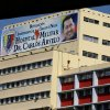 A banner bearing a photo of Venezuela\'s President Hugo Chavez is displayed on a building of the Carlos Arvelo Military Hospital in Caracas, where the ailing leader is expected to continue his treatment, in Caracas, Venezuela, Monday, Feb. 18, 2013. Chavez returned to Venezuela early Monday after more than two months of medical treatment in Cuba following cancer surgery, and was being treated at the Caracas\' military hospital, his government said. (AP Photo/Fernando Llano)