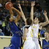 Coyle\'s Fidel Simpson puts up a shot over Arnett\'s Ryne Friesen, center, and Trevor Bryant during the Class B boys state championship game between Coyle and Arnett in the State Fair Arena at State Fair Park in Oklahoma City, Saturday, March 2, 2013. Photo by Bryan Terry, The Oklahoman
