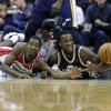 Washington Wizards\' Jordan Crawford, left, fights for the ball against Utah Jazz\'s DeMarre Carroll, right, during the first half of an NBA basketball game, Saturday, Nov. 17, 2012, in Washington. (AP Photo/Nick Wass)