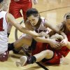 Photo - Washington's Dagan Lampkin, left, and Amber Madden fight for the ball with Kingston's Mikyla Wells during a girls high school basketball game in Washington, Okla., Friday, Feb. 17, 2012. Photo by Bryan Terry, The Oklahoman