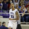 Photo - TCU forward Garlon Green (33) celebrates a 3-point shot during the first half of an NCAA college basketball game against Kansas on Wednesday, Feb. 6, 2013, in Fort Worth, Texas. (AP Photo/Sharon Ellman)