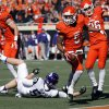 Oklahoma State\'s Josh Stewart (5) runs past TCU\'s James Power (50) for a kick return touchdown during a college football game between the Oklahoma State University Cowboys (OSU) and the Texas Christian University Horned Frogs (TCU) at Boone Pickens Stadium in Stillwater, Okla., Saturday, Oct. 19, 2013. Photo by Chris Landsberger, The Oklahoman