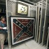 Photo - In this Oct. 11, 2013 photograph, Cindy Gardner, Director of Collections and Museum Division Project Manager, for the Museum of Mississippi History at the Mississippi Department of Archives and History shows off a Confederate battle flag and era painting that will be among the items that will eventually be displayed in the state history museum that will be built along side a museum documenting civil rights in the state, in Jackson, Miss.  The two museums will have more than 200,000 square feet combined and are to be built not far from the Capitol in Jackson. The state has committed $40 million to the museums, and Holmes said officials are trying to raise $14 million in private donations. (AP Photo/Rogelio V. Solis)