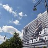 Photo - German national soccer player Mesut Ozil  is visible  on the facade of a publisher's building at Alexanderplatz  square in Berlin, Germany, Friday June 6, e 2014. Sportswear manufacturer Adidas has put up the advertisement on the entire facade of the building prior to the soccer World Cup  tournament  in Brazil. (AP Photo/dpa,Jens Kalaene)