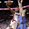 Miami\'s Dwyane Wade (3) goes to the basket past Oklahoma City\'s Nick Collison (4) during Game 4 of the NBA Finals between the Oklahoma City Thunder and the Miami Heat at American Airlines Arena, Tuesday, June 19, 2012. Oklahoma City lost 104-98. Photo by Bryan Terry, The Oklahoman