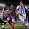 Photo - FC Barcelona's Francesc Fabregas, left , tries to control the ball in front with Real Sociedad's David Zurutuza, during their Spanish Copa del Rey semifinal second leg soccer match, at Anoeta stadium, in San Sebastian northern Spain, Wednesday, Feb. 12, 2014. (AP Photo/Alvaro Barrientos)