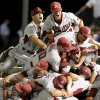 Photo -   Arkansas players pile on top of each other after defeating Baylor in the 10th inning of an NCAA college baseball tournament super regional game, Monday, June 11, 2012, in Waco, Texas. Arkansas advances to the College World Series. (AP Photo/Waco Tribune Herald, Jerry Larson)