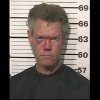 Photo -   This photo provided by the Grayson County, Texas, Sheriff's Office shows Country singer Randy Travis who has been charged with driving while intoxicated. Authorities say Travis was being jailed without bond Wednesday, Aug. 8, 2012, pending an appearance before a judge in Sherman, Texas, about 60 miles north of Dallas. (AP Photo/Grayson County Sheriff's Office)