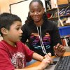 University of Central Oklahoma student Jakky Finley helps Linwood Elementary School third-grader Patrick Goolsby with his reading using a laptop computer. Photo by Jim Beckel, The Oklahoman