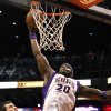 Phoenix Suns\' Jermaine O\'Neal (20) goes in for a dunk as Portland Trail Blazers\' Joel Freeland, of England, looks on during the second half of an NBA basketball game Wednesday, Nov. 21, 2012, in Phoenix. The Suns defeated the Trail Blazers 114-87. (AP Photo/Ross D. Franklin)