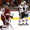 Chicago Blackhawks\' Patrick Kane (88) celebrates his goal against Phoenix Coyotes\' Mike Smith, left, his second of the period, with teammate Jonathan Toews (19) during the first period in an NHL hockey game Thursday, Feb. 7, 2013, in Glendale, Ariz.(AP Photo/Ross D. Franklin)