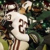 Santa Fe\'s Quantrell Young (12) takes down Memorial\'s Waylan Anderson (23) during a high school football game between Edmond Memorial and Edmond Santa Fe at Wantland Stadium in Edmond, Okla., Friday, Oct. 26, 2012. Photo by Garett Fisbeck, The Oklahoman