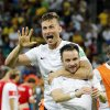 Photo - France's Olivier Giroud, left,  and  Mathieu Valbuena celebrate after the group E World Cup soccer match between Switzerland and France at the Arena Fonte Nova in Salvador, Brazil, Friday, June 20, 2014.  The match ended in a 5-2 win for France. (AP Photo/David Vincent)