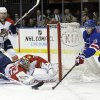Florida Panthers goalie Jacob Markstrom (35) stops a shot on the goal by New York Rangers\' Chris Kreider (20) during the second period of an NHL hockey game Thursday, March 21, 2013, in New York. (AP Photo/Frank Franklin II)
