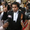 Photo - An unidentified lawyer from the prosecution side displays a victory sign as he speaks to journalists after a judge pronounced death sentence for all four men convicted in the rape and murder of a student on a moving New Delhi bus last year, in New Delhi, India, Friday, Sept. 13, 2013. The judge on Friday ordered all four to the gallows for a brutal attack on a bus that left the young woman with such severe internal injuries that she died two weeks later. (AP Photo/Saurabh Das)