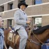 Photo - Charles Barkley, former NBA player and current studio analyst, arrives on horseback for Game 3 of the NBA basketball Western Conference finals playoff series between the San Antonio Spurs and the Oklahoma City Thunder, Thursday, May 31, 2012, in Oklahoma City. (AP Photo/Sue Ogrocki)