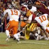 ISU\'s Jeff Woody (32) rushes for the winning score in double overtime as Markelle Martin (10) and Brodrick Brown (19) defend during a college football game between the Oklahoma State University Cowboys (OSU) and the Iowa State University Cyclones (ISU) at Jack Trice Stadium in Ames, Iowa, Friday, Nov. 18, 2011. Iowa State won, 37-31, in double overtime. Photo by Nate Billings, The Oklahoman