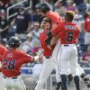 Photo - Mississippi players from left: Brantley Bell (28), John Gatlin, Aaron Greenwood and Errol Robinson celebrate their 2-1 win over Texas Tech in an NCAA baseball College World Series elimination game in Omaha, Neb., Tuesday, June 17, 2014. (AP Photo/Eric Francis)