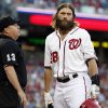 Photo - Washington Nationals' Jayson Werth listens to home plate umpire Todd Tichenor, who called Werth out looking during the first inning of a baseball game against the Atlanta Braves at Nationals Park on Friday, June 20, 2014, in Washington. (AP Photo/Alex Brandon)