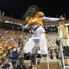 Photo - Tennessee linebacker A.J. Johnson (45) leaps off a stepladder in celebration after Tennessee beat Utah State 38-7 at Neyland Stadium, Sunday, Aug. 31, 2014 in Knoxville, Tenn.  (AP Photo/Knoxville News Sentinel, Adam Lau)