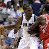 Photo -   Dallas Mavericks' Elton Brand (42) looks for an opening against Houston Rockets' Patrick Patterson during the first half of a preseason NBA basketball game, Monday, Oct. 15, 2012, in Dallas. (AP Photo/Tony Gutierrez)