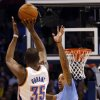 Oklahoma City \'s Kevin Durant (35) ties for a three-point shot as Los Angeles\' Matt Barnes (22) defends during the NBA game between the Oklahoma City Thunder and the Los Angeles Clippers at the Chesapeake Energy Arena, Sunday, Feb. 23, 2014. Photo by Sarah Phipps, The Oklahoman
