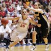 OU\'s Whitney Hand (25) dribbles past Missouri\'s Morgan Eye (30) during the Big 12 tournament women\'s college basketball game between the University of Oklahoma Sooners and the University of Missouri Tigers at Municipal Auditorium in Kansas City, Mo., Thursday, March 8, 2012. OU won, 70-59. Photo by Nate Billings, The Oklahoman