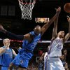 Oklahoma City\'s Kevin Martin (23) goes for the rebound beside Dallas\' Vince Carter (25) during an NBA basketball game between the Oklahoma City Thunder and the Dallas Mavericks at Chesapeake Energy Arena in Oklahoma City, Thursday, Dec. 27, 2012. Photo by Bryan Terry, The Oklahoman