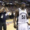 Memphis Grizzlies forward Zach Randolph (50) celebrates after beating the Oklahoma City Thunder in Game 6 of a second-round NBA basketball playoff series on Friday, May 13, 2011, in Memphis, Tenn. Randolph led the Grizzlies with 30 points as they won 95-83 to even the series 3-3. (AP Photo/Wade Payne)