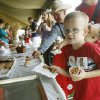 Five year old Konnyr Summers picks up a cinnamon roll during Septemberfest at the Governor\'s Mansion in Oklahoma City, OK, Saturday, Sept. 6, 2008. BY PAUL HELLSTERN, THE OKLAHOMAN