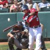 Redhawks\' L.J. Hoes hits a popup fly during their game against the Salt Lake Bees at the Chickasaw Bricktown Ballpark in Oklahoma City, Wednesday June 11, 2014. Photo By Steve Gooch, The Oklahoman