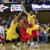 West Virginia\'s Gary Browne, left, and Keaton Miles (55) defend Radford\'s Rashun Davis (5) during the second half of an NCAA college basketball game at WVU Coliseum in Morgantown, W.Va., Saturday, Dec. 22, 2012. West Virginia defeated Radford 72-62. (AP Photo/David Smith)