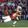 Oklahoma State \'s Brodrick Brown (19) deflects a pass that was intercepted by the Cowboys\' James Thomas (22) sealing OSU\'s win on Saturday in College Station, Texas. Photo by Sarah Phipps, The Oklahoman