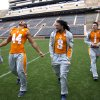 Photo - University of Tennessee NCAA college football signees Jakob Johnson, of Jacksonville, Fla., left, Von Pearson, of Newport News, Va., and Jalen Hurd, of Hendersonville, Tenn., walk in Neyland Stadium after being introduced on Wednesday, Feb. 5, 2014, in Knoxville, Tenn. (AP Photo/Knoxville News Sentinel, Saul Young)