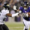 Photo -   Baltimore Ravens wide receiver Torrey Smith, right, rushes past Jacksonville Jaguars defensive back Dwight Lowery in the second half of an NFL preseason football game in Baltimore, Thursday, Aug. 23, 2012. (AP Photo/Gail Burton)