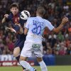 Photo -   FC Barcelona's Lionel Messi from Argentina, left, duels for the ball against against Granada's Borja Gomez during a Spanish La Liga soccer match at the Camp Nou stadium in Barcelona, Spain, Saturday, Sept. 22, 2012. (AP Photo/Manu Fernandez)