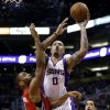 Phoenix Suns\' Michael Beasley (0) shoots over Toronto Raptors\' Alan Andrson during the second half of an NBA basketball game, Wednesday, March 6, 2013, in Phoenix. (AP Photo/Matt York)