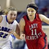 Erick\'s Maranda Janz dribbles up court as Lomega\'s Ashley LaGasse defends during the Class B girls state championship between Erick and Lomega at the State Fair Arena., Saturday, March 2, 2013.. Photo by Sarah Phipps, The Oklahoman