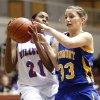 Lauren Fonteno of Millwood tries to get past Piedmont\'s Sarah Parker during a girls high school basketball game at Southern Nazarene University in Bethany, Okla., Friday, Jan. 7, 2011. Photo by Bryan Terry, The Oklahoman ORG XMIT: KOD