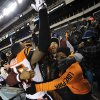 Cincinnati Bengals\' Jeromy Miles celebrates in the stands after an NFL football game against the Philadelphia Eagles, Thursday, Dec. 13, 2012, in Philadelphia. Cincinnati won 34-13. (AP Photo/Michael Perez)