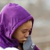 Mariah Brant cries as she visits the crash site that killed her half-brother, Daylan Ray, early in the morning on Park Ave. in Warren, Ohio on Sunday, March 10, 2013. (AP Photo/Scott R. Galvin)