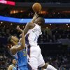 Photo - Charlotte Bobcats' Michael Kidd-Gilchrist (14) shoots over New Orleans Hornets' Anthony Davis (23) during the first half of an NBA basketball game in Charlotte, N.C., Saturday, Dec. 29, 2012. (AP Photo/Chuck Burton)