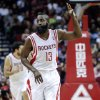 Houston Rockets guard James Harden (13) signals after making a 3-point basket against the Milwaukee Bucks during the first half of an NBA basketball game, Wednesday, Feb. 27, 2013 in Houston. (AP Photo/Bob Levey)