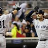 Photo -   New York Yankees' Ichiro Suzuki, left, of Japan, congratulates Nick Swisher after Swisher's two-run home run off Minnesota Twins pitcher Liam Hendriks in the first inning of a baseball game, Monday, Sept. 24, 2012, in Minneapolis. (AP Photo/Jim Mone)