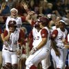 Photo - Alabama's Jadyn Spencer celebrates with teammates as she crosses home after hitting a two-run home run in the fifth inning of a Women's College World Series game between at ASA Hall of Fame Stadium in Oklahoma City Thursday, May 29, 2014. Photo by Bryan Terry, The Oklahoman